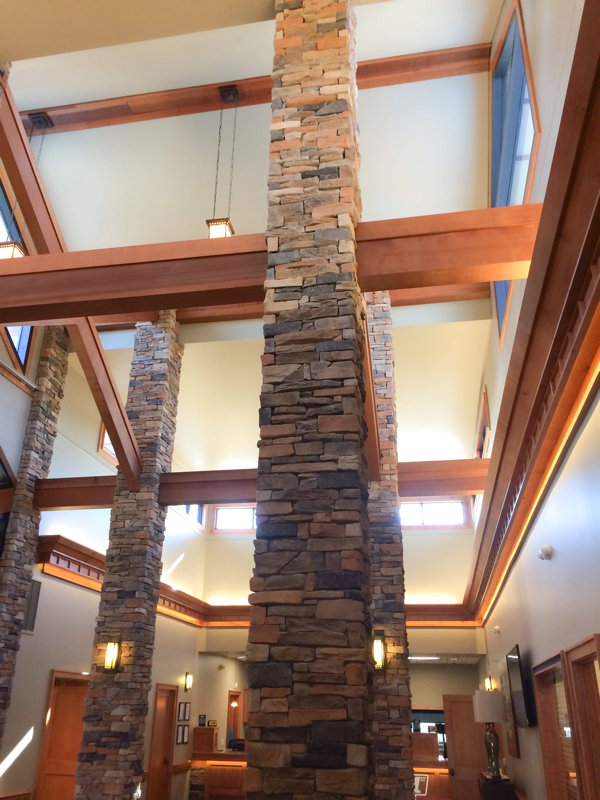 stone column and wood beams for a bank office design